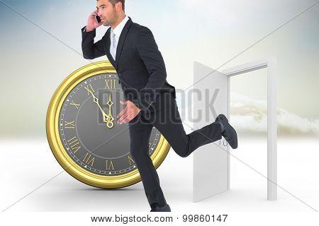 Businessman running on the phone against open door in sky