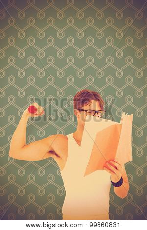 Geeky hipster lifting dumbbells and reading notepad against blue background