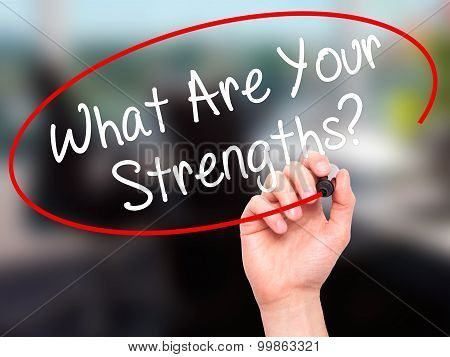 Man Hand writing What Are Your Strengths? with black marker on visual screen.