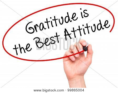 Man Hand writing Gratitude is the Best Attitude with black marker on visual screen.