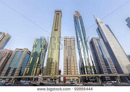 View of skyscrapers and Dubai Metro along Sheikh Zayed Road, Dubai UAE