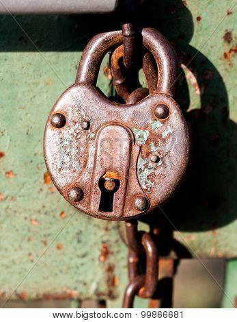 Old weathered grunge rusty locked padlock