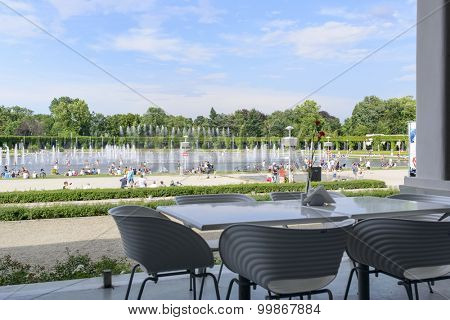 WROCLAW - JULY 19: The view from the empty restaurant on people cooling using public fountains in the hottest day on 19 July 2015 in Wroclaw, Poland. In this year there was a record high temperature.