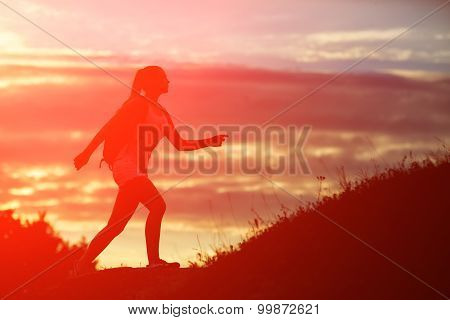 Young Woman With Red Backpack Walking On Sunset Summer.