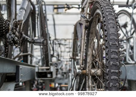 Closeup Of Rows Of Commuter Bikes At A Train Station
