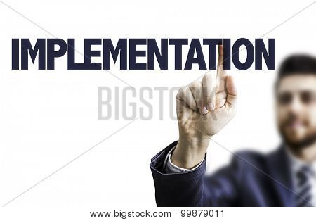 Businessman pointing the text: Implementation