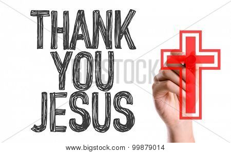 Hand with marker writing the word Thank You Jesus