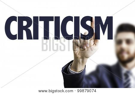 Businessman pointing the text: Criticism