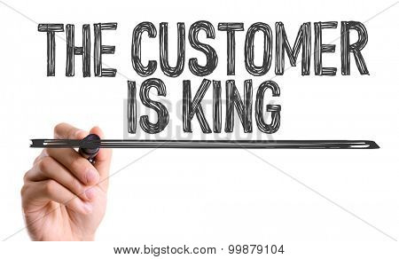 Hand with marker writing the word The Customer is King