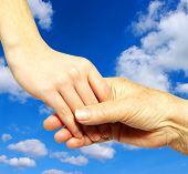 picture of holding hands  - help of youths old people on sky - JPG