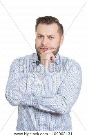 adult male with a beard. isolated on white background. finger under his chin. gestures thought. deci