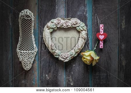 Frame And Shoes On Wooden