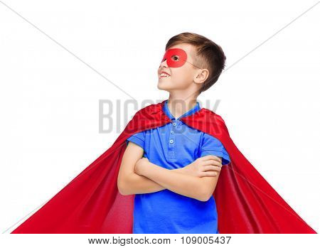 carnival, childhood, power, gesture and people concept - happy boy in red super hero cape and mask