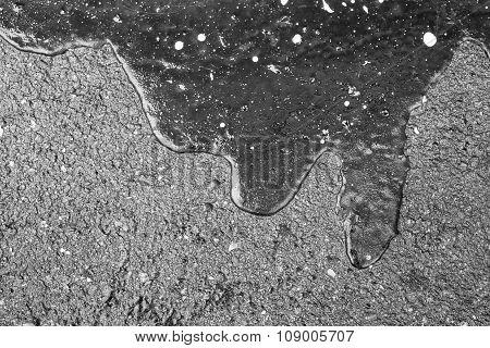 Bitumen Abstract Form On Asphalt Of Monochrome Tone