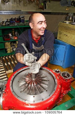 Cheerful, Smiling Muslim Turbocharger Impeller Repairs In Factory Workshop.