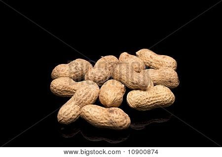 Peanuts (monkey Nuts) In Shells On A Black Background