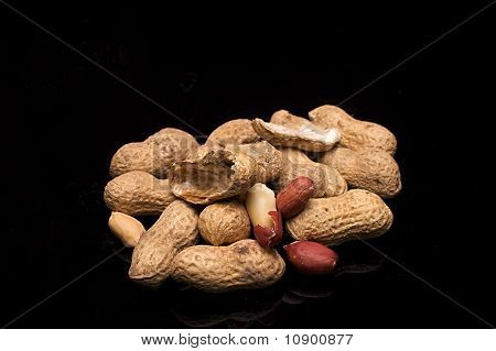 Peanuts (monkey Nuts) On A Black Background