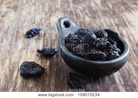 Dried Prunes In A Bowl