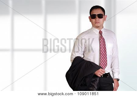 Young And Proud Asian Businessman