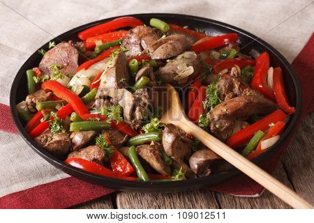 Fried Chicken Liver With Peppers Close-up On A Dish. Horizontal