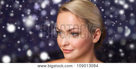 people, beauty, spa, healthy lifestyle and relaxation concept - close up of beautiful young woman at bath or sauna with snow effect