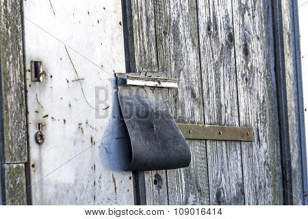 Padlock On Old Abandoned Barn