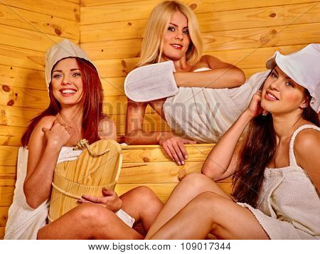 Group people young women relaxing in sauna.