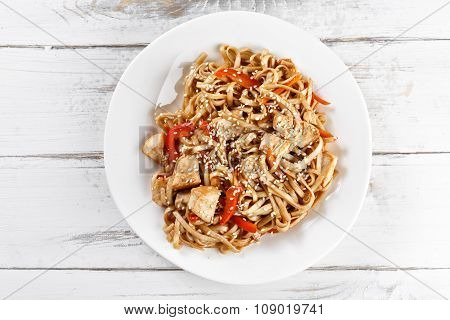 Fried Udon Noodles With Chicken On Wooden Table. Pad Thai