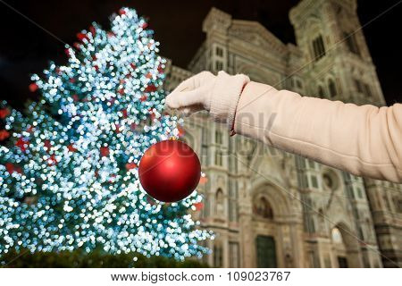 Closeup On Hand Pretend Decorating Christmas Tree In Florence
