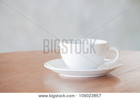 White Coffee Cup On Wooden Table With Clipping Path