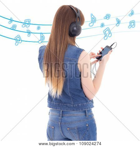 Back View Of Woman Listening Music With Mobile Phone Over White