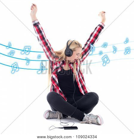 Happy Teenage Girl Listening Music In Headphones Over White