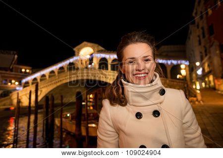 Happy Woman Standing In Front Of Rialto Bridge In Venice, Italy