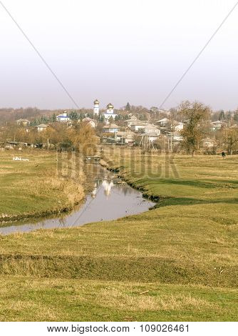 Orthodox church domes reflected in village creek