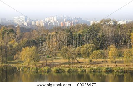 Calm lake in autumn park, beautiful panorama