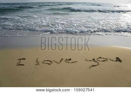 Handwriting Word I Love You Written  In The Sand