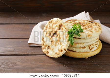 stack of homemade tortillas pita on a wooden table