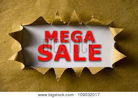 Torn Brown Paper With Mega Sale Words
