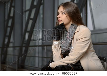Woman With A Bag In Her Lap In Waiting For Departure