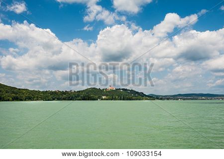 landscape, azure water and blue sky, coast on the horizon