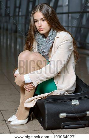 Girl Waits Flight Sitting On Suitcases