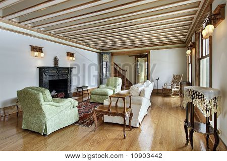 Living Room With Wood Trimmed Ceiling