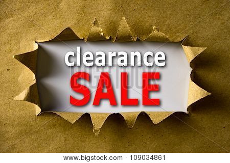 Torn Brown Paper With Clearance Sale Words
