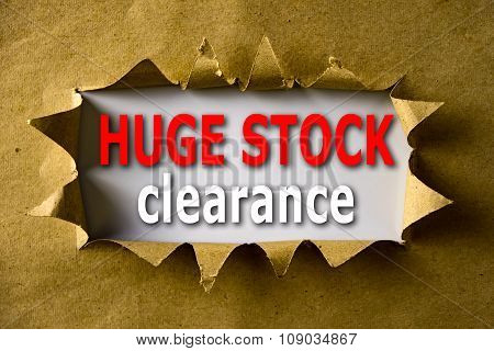 Torn Brown Paper With Huge Stock Clearance Words