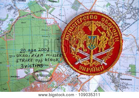 Kiev, Ukraine.OCT 19.Illustrative editorial. Chevron of Ukrainian Army.Background map with military disaster at 2002.At October 19, 2015 in Kiev, Ukraine