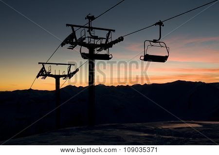 Ski-lift Silhouette Against Sundown Sky