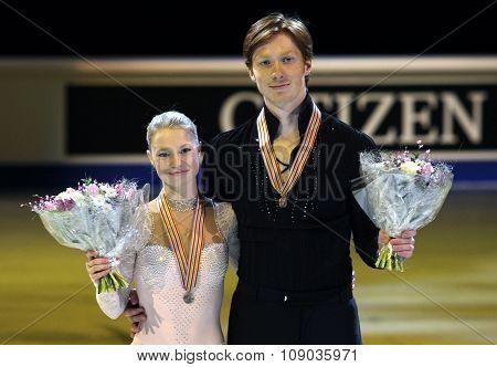 Evgenia Tarasova / Vladimir Morozov Pose With Bronze Medals