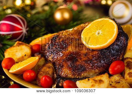 Christmas Baked Duck Served With Potatoes, Orange And Tomatoes