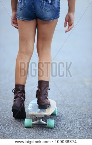 closeup girl on a skate board