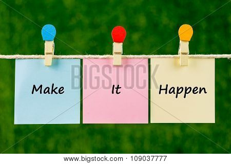 Words Of Make It Happen On Sticky Color Papers Hanging By A Rope.